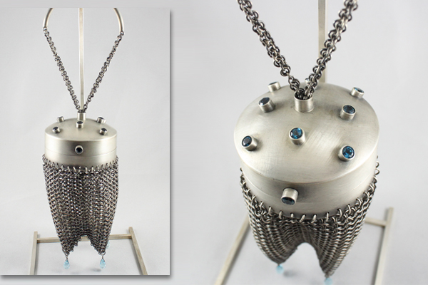 round silver chain mail purse with faceted blue topaz